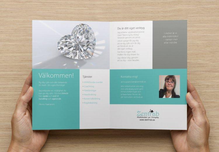Insidan av Zentrabs broschyr med en bild på en hjärtformad diamant och ett porträtt på Anno Paananen.